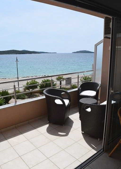 Apartment in the first row to the sea on the top location near Sibenik